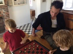 The Youngest Takes On 2 Opponents in Checkers