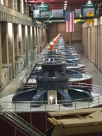 The turbines and giant crane inside the generator room of the Hoover Dam.